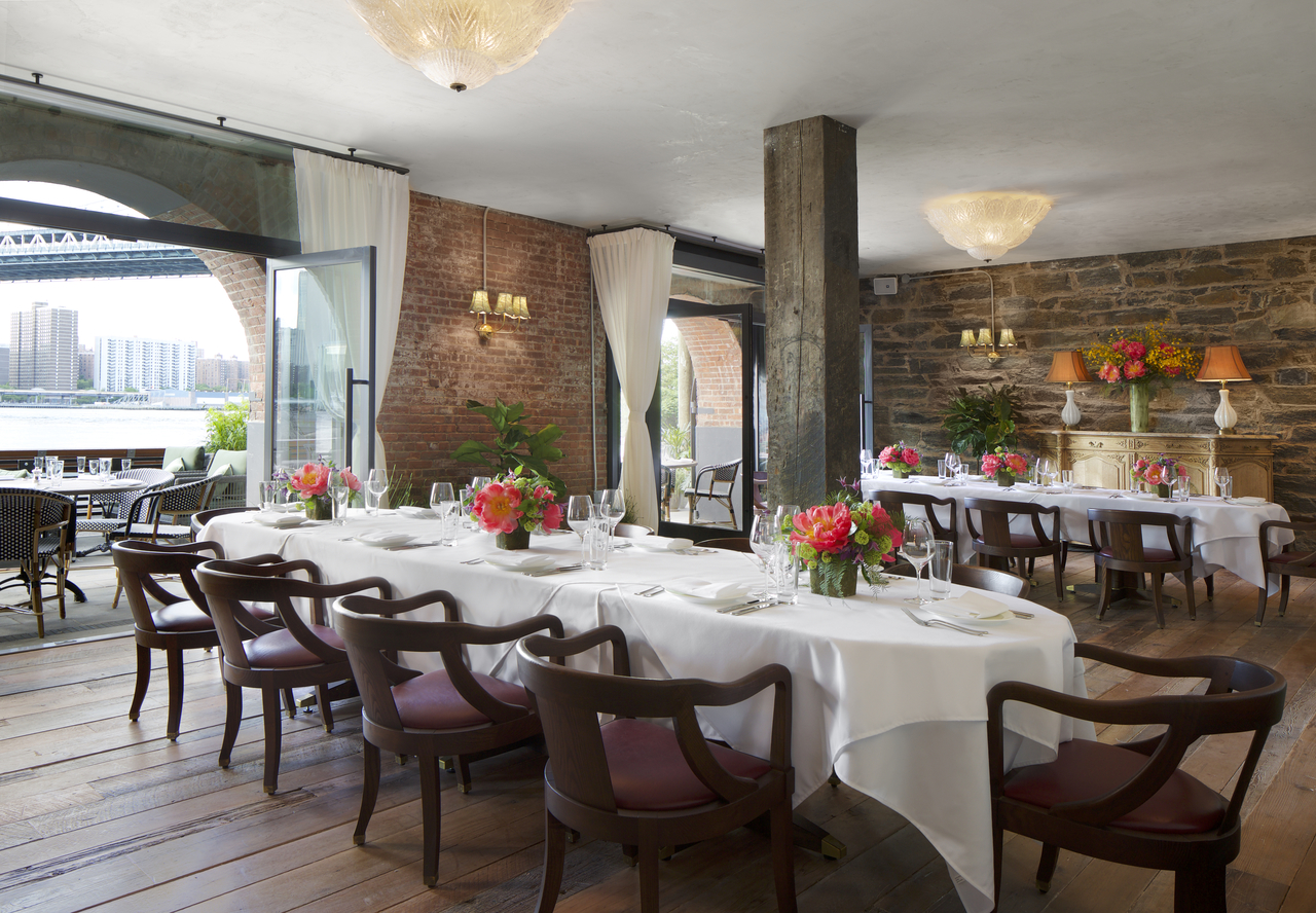 Exposed brick wall dining room with flowers
