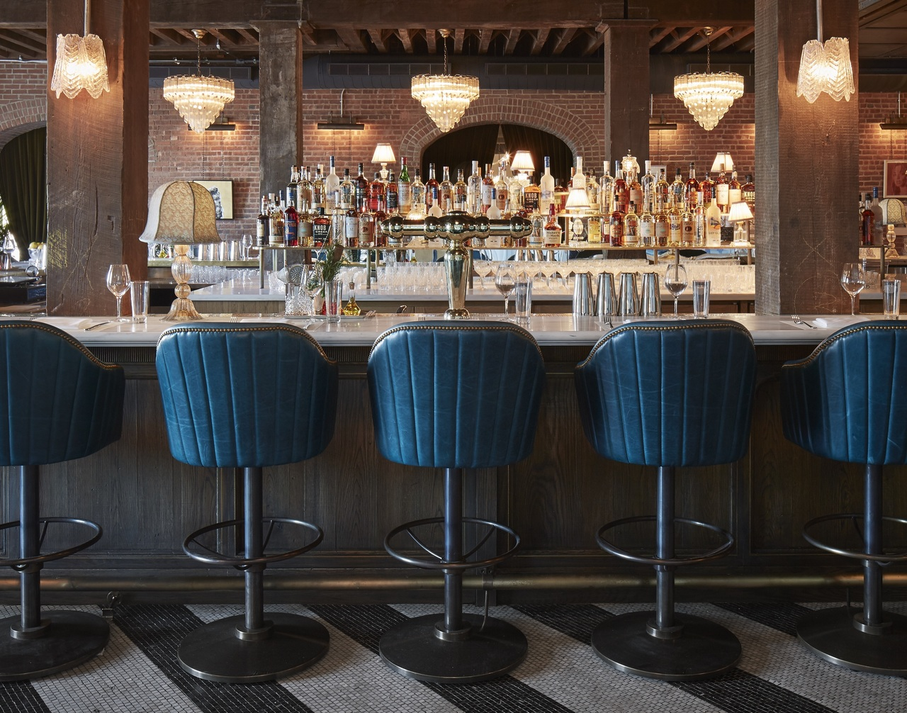 A bar, leather stools and classic Italian furnishings